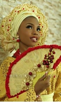 Gold/red lace and Aso oke gele with hand fan
