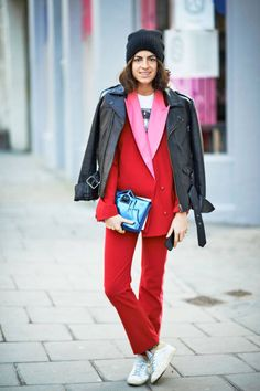 A bold red and pink suit, topped off with a tough looking motorcycle jacket #streetstyle