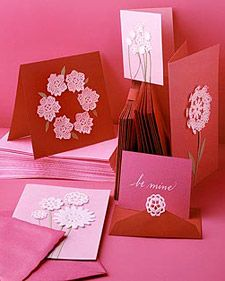 Dress up a handmade Valentine's Day card with inexpensive paper doilies.