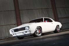 Do good guys always wear white? Another amazing build by Chris Holstrom Concepts, Phil's incredible '69 Camaro is powered by a 850HP Magnuson-supercharged 416ci Wegner Motorsports LS3 and rides on an Art Morrison chassis, Strange coilovers, Baer brakes, 285/35ZR18 & 335/30ZR19 Nitto NT05 tires, and 18x10/19x12 Forgeline ZX3P wheels finished with Gunmetal centers & Polished outers! See more at: http://www.forgeline.com/customer_gallery_view.php?cvk=1216  Photo courtesy of Super Chevy…