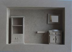 Quadro com miniaturas casa de banho