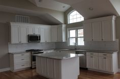 Traditional Kitchen with Complex granite counters, Flush, Undermount sink, Kitchen island, High ceiling, L-shaped
