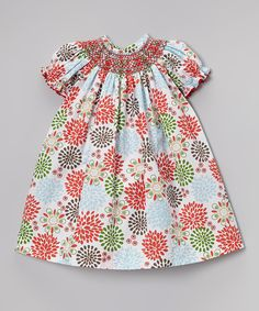 Swirling with a pretty poppy pattern, this darling dress is a perfect holiday addition. A smocked neckline and elastic arm openings mean ladies stay comfy and changing is easy, while the festive color combo makes it perfect for special occasion wear.65% polyester / 35% cottonMachine wash; tumble dryImported