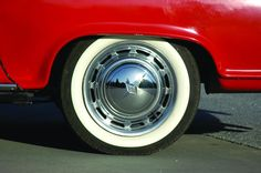 Image 18 of 19: The 14-inch wheels, one inch larger than stock, wear Borgward hubcaps and Mercedes trim rings.