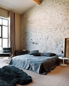 simple bedroom w/ terrific tall, bricked accent wall & ceiling beams