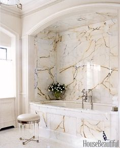 """We were so lucky to come across this marble. It's no longer available and there was just enough for the master bathroom. The architect paid a lot of attention to the placement of the veining to show off the beauty of the stone,"" says designer Nancy Boszhardt of the space in a New York house. Bathtub from Ann Sacks."