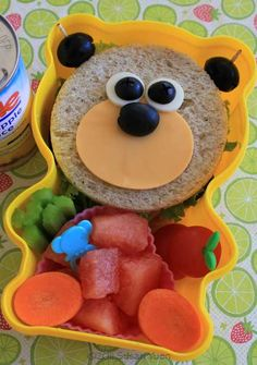 Kids Lunch-This cute little bear looks pretty easy to make.  See 13 more fun sandwiches for the kids lunch-at home or school.  www.itswrittenonthewall.com