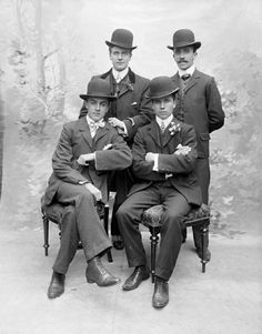 Gentlemen, between 1900 and 1910 with hats and some with and without facial hair.