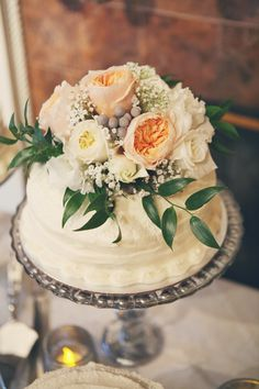 flower topped wedding cake // photo by Heather Hester // cake by Andrew Michael Italian Kitchen