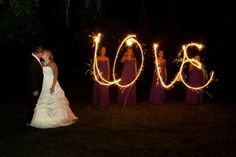 Pam and Chris - I have always loved sparklers. The photographers were great at being able to capture the image the very first try. - Artistic Images Photography