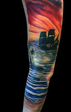 Enthralling beach tattoo with a ship on the horizon. The ship is inked in silhouette style making it look mysterious as it slowly approaches the tranquil beach shore in the sunset.