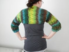 Knitted bolero from 100% wool.