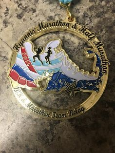 Half Marathon medals shared by 50 States Half Marathon Club™ www.50stateshalfmarathonclub.com members - 2016 Hyannis Marathon & Half Marathon medal - race bling