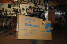 Recycle-A-Bicycle Mechanic Christopher Izaguirre moves one of the 100 Revel 2 mountain bikes donated by Giant for use as transportation by people most affected by Hurricane Sandy.