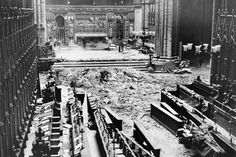 Westminster Abbey High Altar: debris from collapsed Lantern Roof, 11 May 1941. On the outbreak of World War II, many of Westminster Abbey's treasures were evacuated for safety to country houses. About 60,000 sandbags were used to protect immoveable royal and medieval tombs. The Coronation Chair was sent for safety to Gloucester Cathedral and the Coronation Stone was buried secretly within the Abbey. The collection of wax funeral effigies was stored in Piccadilly tube station.