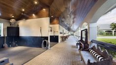 horse barn aisle with wash stalls open to center courtyard. perhaps with windows that come down and close for our Canadian winters? Barn Stalls, Horse Stalls, Horse Barns, Dream Stables, Dream Barn, Equestrian Stables, Future Farms, Horse Property, Beautiful Horses