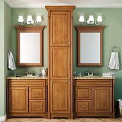 Double vanity made with two individual sink bases and a tower/pantry unit.  Interesting concept.