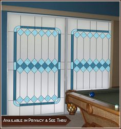 Cambridge I - Tones of blue are artfully presented in this stained glass design (privacy).
