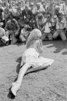 French actress Brigitte Bardot sitting on the grass and being photographed by the journalists at the Venice International Film Festival. Venice, August 1958 Get premium, high resolution news photos at Getty Images Bridgitte Bardot, Catherine Deneuve, Jane Fonda, Marie Christine Barrault, Cannes, Michel Piccoli, Divas, Venice Film Festival, Jeanne Moreau