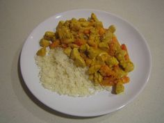 Curry van kip en papaya