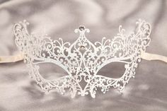 nice and elegant mask for a ball or party.... i recommend wearing this one for a ball its more formal than others