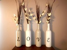 LOVE recycled painted wine bottle wedding decor