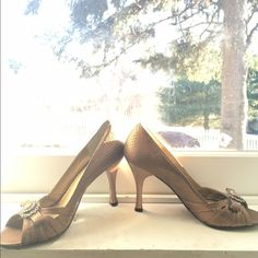 BCBG Paris heels Bronze peep toe heel with snakeskin print and gem detail near toe opening. Real throwback to the old school bcbg style. Size 7 1/2 B. Perfect with an all black work outfit or a tan dress in the summer. BCBG Shoes Heels