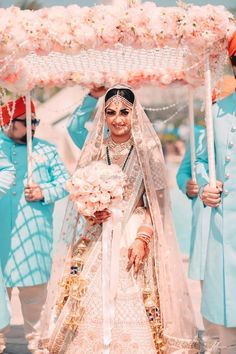 Beautiful ivory lehenga with tulle dupatta and white roses |WedMeGood| Simi & Ketur|#wedmegood #indianweddings #lehenga #white #roses #ivory #bridallehenga #jewellery