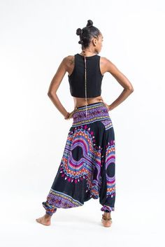 """These magical Low Cut Harem Pants can be converted into a jumpsuit.Cotton/Rayon Blend. It's like buying one outfit but getting two. They are great for lazy Sundays, doing yoga, or hula hooping at a music festival. Free international shipping on all orders over $60. Sizing:One size fitsmost. Measurements:  Waist: 24"""" to 38"""" Hips: up to 44"""" Total length: 37"""""""