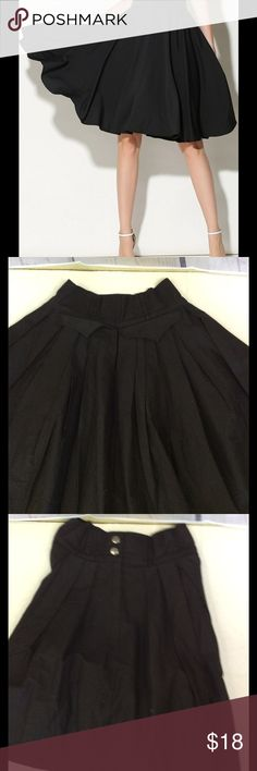 Black flared midi skirt Knee length, flared, party and plain.    Waist size: 13in....  length 22in.   Size:medium Skirts Midi