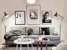 Grey sofa, white & wooden coffee table.