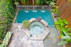 small pool  Large spa, swim jets, waterfall features, and slate decking