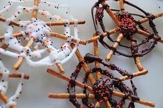 Pretzel spider web treats with halloween sprinkles.