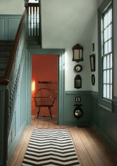 colonial charm. Love the old home character and the addition of a modern chevron rug.