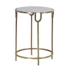 Sometimes less is more and with this simple yet stunning round gold finish table, the Pitchfork hits the nail on the head. The table carries a stone face that adds a slight contemporary twist to the piece. Use this in the garden over summer or as a side table in the house.