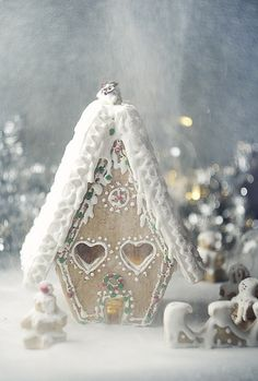 Snowy gingerbread cottage  I think I just found this years ornament!  A bird house painted like a gingerbread house!