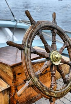 Steering Wheel Sailboat Stock Photo, Picture And Royalty Free Image. Sea Theme, Nautical Theme, Boat Steering Wheels, Boat Navigation, Boat Wheel, Buy A Boat, Sailboat Painting, Beyond The Sea, Boat Art