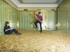 Two activists from the Generation Basic Income Initiative, the group selling the bank vault