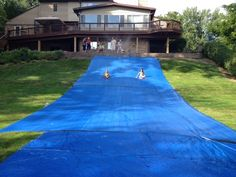 So it was my daughters 8th birthday and  I decided to make a water slide out of our hill. I purchased two 20 x 30 foot tarps and some large nail stakes. staked it along the top and sides so no one would slide over the stakes. Where I met the two together I underlapped them so the water would continue to flow down and then I used gorilla tape over the seam and then added another16 X 20 tarp. Added a sprinkler at the top & they flew down the hill like lighting. It was a big hit.  Fran Jantz