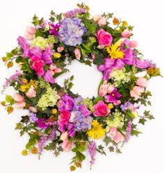 $199 - SW600 Spring Basket Wreath. Gorgeous spring wreath just waiting for the Easter Bunny! Bright spring mix including hydrangea, tulips and daisies. See all our spring wreaths:  http://www.darbycreektrading.com/Spring-Wreaths-C265.aspx