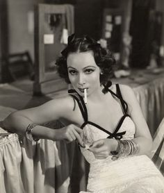 Dolores del Rio looking sultry with that very convenient cigarette as a prop. In reality I don't think she actually smoked.