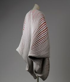 """Seashell"" or ""Shell-knit"" coat, spring/summer 1985   Issey Miyake (Japanese, born 1938)   Gray, pink, red, and lavender cotton/synthetic blend knit with heat-embossed ribbing   Gift of Muriel Kallis Newman, 2003"