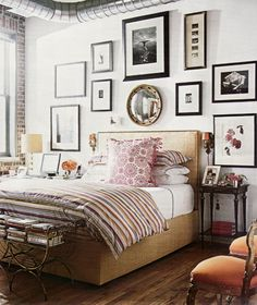 bed + bedding + sconces + bench + chairs (+ exposed brick + ductwork)