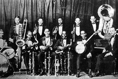 """""""She's Funny That Way"""" by the Goldkette Orchestra. Btw, that's not Goldkette's Orchestra they show in this clip--that's Fletcher Henderson's band. In fact, the guy in the back center holding a cornet is Louis Armstrong who never played for Goldkette. Roseland Ballroom, Jazz Band, Wedding Music, 1920s Wedding, Miles Davis, Jazz Musicians, Jazz Blues, Band Photos, Popular Music"""