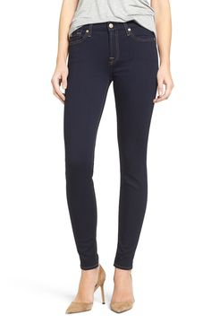 An ultra-saturated indigo wash amplifies the sleek look of these mid-rise skinny jeans with golden contrast stitching and luminous hardware.