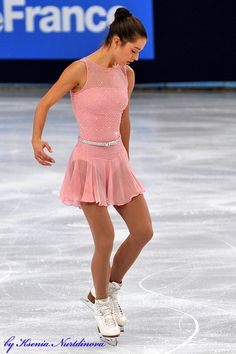 Alissa Czisny. Liking the belt on this pretty skating dress.