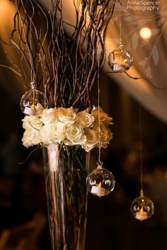 Anna and Spencer Photography, Atlanta Wedding Photographer. White rose and curly willow branch wedding reception table arrangement. Flowers by: Your Event Solutions, Atlanta.