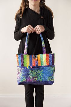 All About Anna Bag Kit by Stephanie Dunphy - ConnectingThreads.com  Divided front pockets help keep you organized. Pattern includes directions for making a fabric handle. http://www.connectingthreads.com/collections/Batik_Paradise_Limited_Edition_Quilting_Fabric__L117.html?media=pinpost