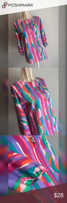 "🎀Vintage Tunic🎀 Multicolored vintage tunic by Sunny South Fashions. Size tag is missing but it fit my mannequin perfectly and she's a size Medium, 7/8. Purple, pink, fuschia, teal, green, light pink, orange, white. Bust 38"" lying flat, stretches to 39"". Shoulder to hem length 26"". Sunny South Fashions Tops"