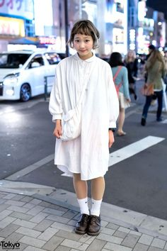 Nari is a supercute vintage and resale fashion loving girl who we often see around Harajuku. Nari works at the Shimokitazawa vintage/resale shop Ragla Magla. When we met Nari in Harajuku this time, she was wearing an (almost) all-white look that features an oversized resale t-shirt dress with resale leather shoes, Nike socks, a white cloth bag, a ring, and a Casio G-Shock watch. Her cute short hairstyle and makeup are also key elements of her look. (Tokyo Fashion, 2014)